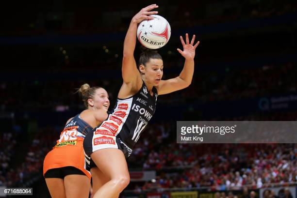 Madi Robinson of the Magpies is challenged by JamieLee Price of the Giants during the round nine Super Netball match between the Giants and the...