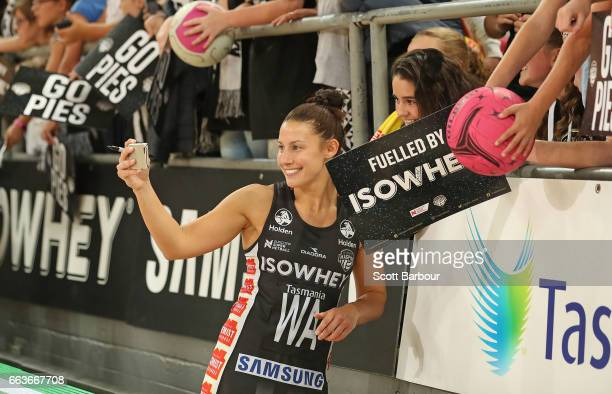 Madi Robinson of the Magpies takes a selfie with a fan in the crowd after the round seven Super Netball match between the Magpies and the Vixens at...