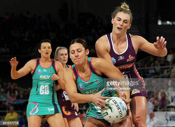 Madi Robinson of the Vixens and Gabi Simpson of the Firebirds compete for the ball during the ANZ Championship Grand Final match between the Vixens...
