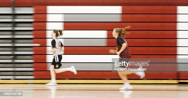 Madi Scott and Jordan Bickford warm up as the Greely High School girls basketball team has their first practice of the season