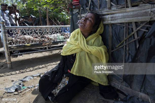 Madia Khatun a relative grieves next to the bodies of 5 children after an overcrowded boat carrying Rohingya fleeing Myanmar capsized overnight...