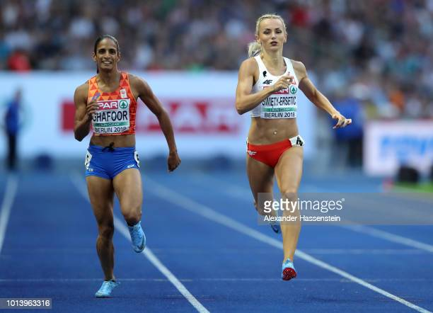 Madiea Ghafoor of the Netherlands and Justyna SwietyErsetic of Poland compete in the Women's 400m semi final during day three of the 24th European...