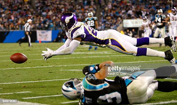 Madieu Williams of the Minnesota Vikings nearly intercepts a pass intended for Steve Smith of the Carolina Panthers at Bank of America Stadium on...