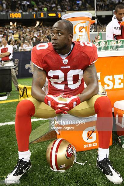 Madieu Williams of the San Francisco 49ers sits on the field prior to the game against the New Orleans Saints at the Louisiana Superdome on August 12...
