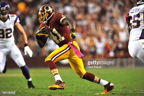 Madieu Williams of the Washington Redskins intercepts a pass and returns it for a touchdown against the Minnesota Vikings at FedExField on October 14...