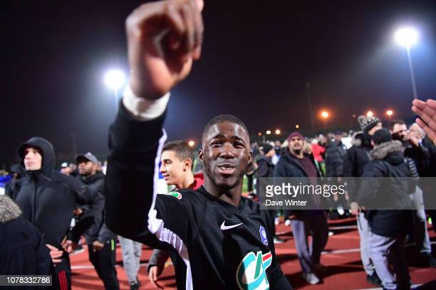Madimoussa Coulibaly of Noisy Le Grand FC celebrates after his team wins the French Cup match between Noisy le Grand and Gazelec Ajaccio on January 6...