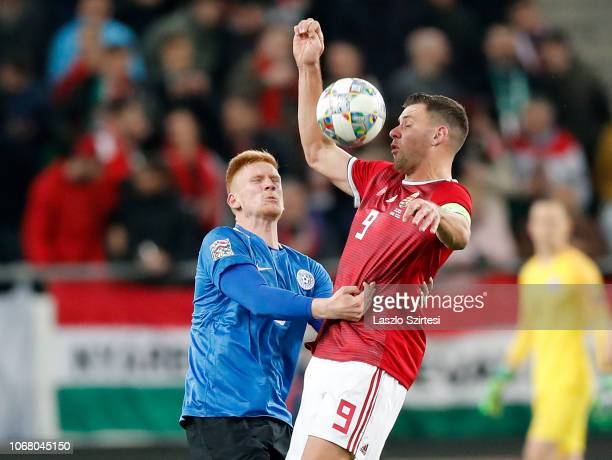 Madis Vihmann of Estonia battles for the ball in the air with Adam Szalai of Hungary during the UEFA Nations League group stage match between Hungary...