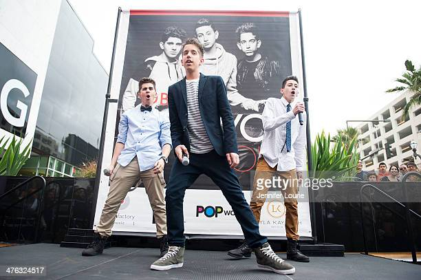 Madison Alamia Jason Smith and Mikey Fusco of band To Be One performs at the Glendale Galleria on March 2 2014 in Glendale California