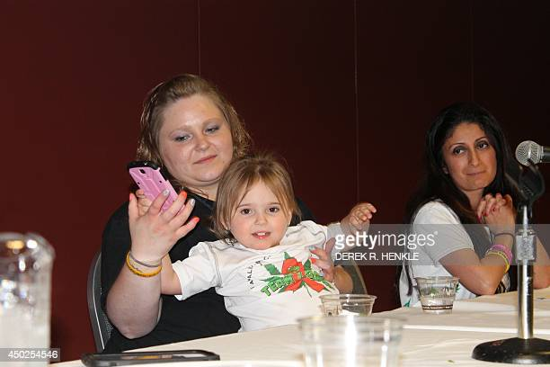 Madison and mother Kimberly Ewell present on a panel in support of medical marijuana access for children June 7 2014 Madison is part of 'Team Logan'...