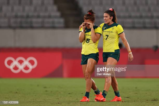 Madison Ashby and Charlotte Caslick of Team Australia look dejected at full time in the Women's Quarter Final match between Team Fiji and Team...