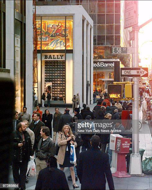 Madison Ave at the corner of E 58th St is crowded with shoppers and other pedestrians as the holiday season gets underway