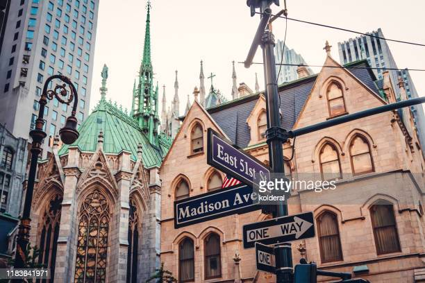 madison avenue and east 51 street sign in midtown manhattan - madison avenue stock pictures, royalty-free photos & images