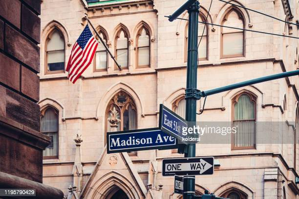 madison avenue and east 51st street signs in midtown manhattan - madison avenue stock pictures, royalty-free photos & images