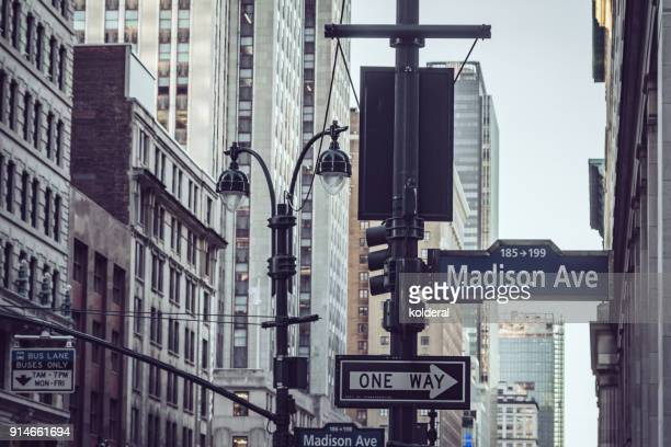 madison avenue directions signs. manhattan, new york - madison avenue stock pictures, royalty-free photos & images