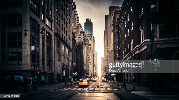 madison avenue street scene in late light - madison avenue stock pictures, royalty-free photos & images