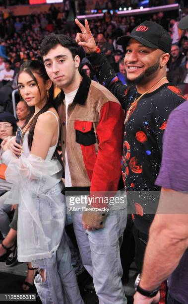 Madison Beer Zack Bia and Ben Beard attend a basketball game between the Los Angeles Lakers and the Phoenix Suns at Staples Center on January 27 2019...