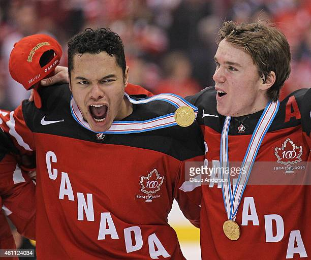 Madison Bowey and Connor McDavid of Team Canada whoop it up after defeating Team Russia in the gold medal game in the 2015 IIHF World Junior Hockey...