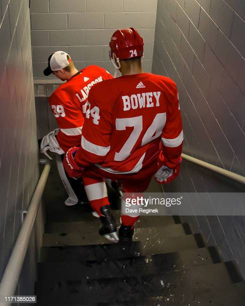 Madison Bowey and Filip Larsson of the Detroit Red Wings walk down the stairs to the locker room after a preseason Kraft Hockeyville game against the...