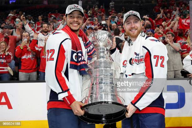 Madison Bowey and Travis Boyd of the Washington Capitals pose with the Stanley Cup after their team's 43 win over the Vegas Golden Knights in Game...