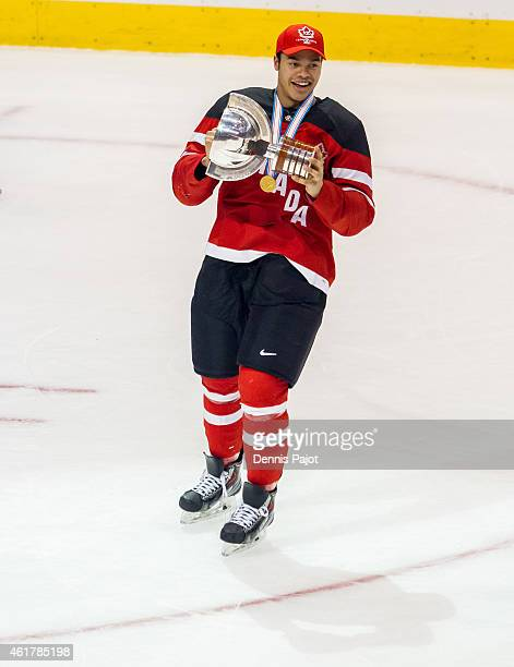 Madison Bowey of Canada celebrates with the trophy after a 54 win against Russia during the Gold medal game of the 2015 IIHF World Junior...