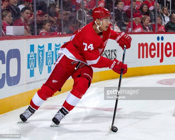 Madison Bowey of the Detroit Red Wings skates around the net with the puck against the Buffalo Sabres during an NHL game at Little Caesars Arena on...