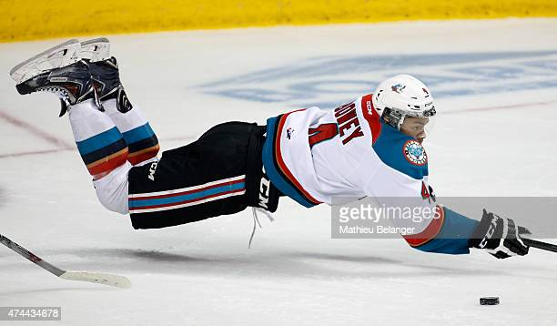 Madison Bowey of the Kelowna Rockets loses the puck as he falls on the ice during Game One of the Memorial Cup against the Quebec Remparts at the...