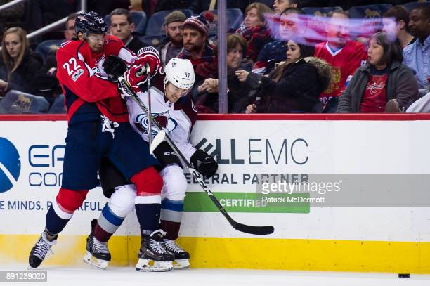 Madison Bowey of the Washington Capitals and Gabriel Bourque of the Colorado Avalanche collide in the second period at Capital One Arena on December...