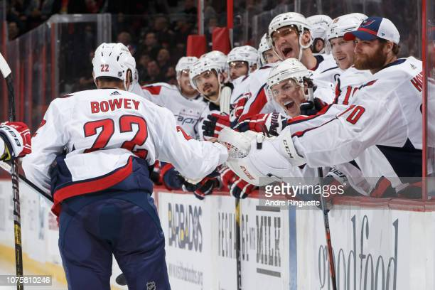 Madison Bowey of the Washington Capitals celebrates his first career NHL goal in the second period of a game against the Ottawa Senators with...