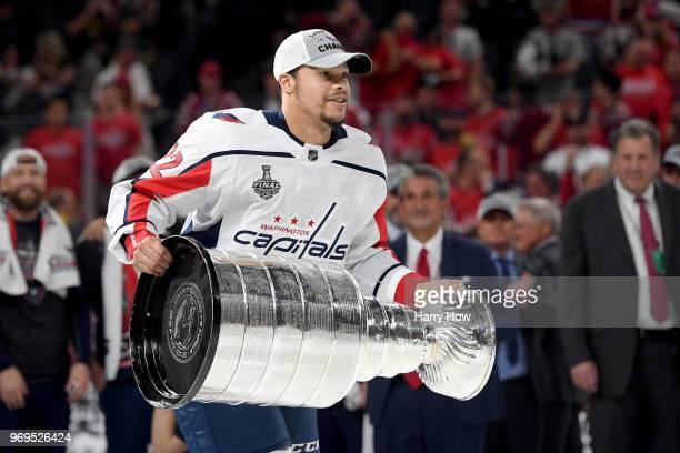 Madison Bowey of the Washington Capitals hoists the Stanley Cup after his team defeated the Vegas Golden Knights 43 in Game Five of the 2018 NHL...