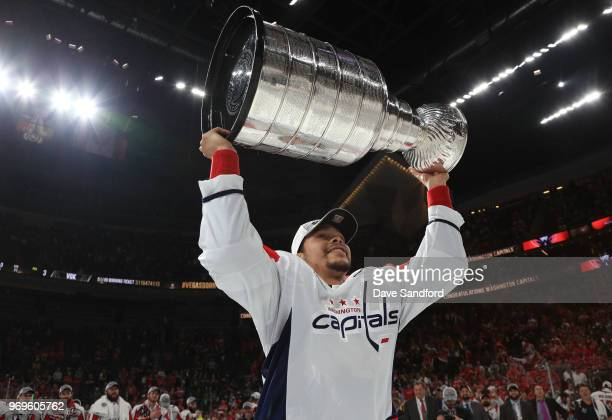 Madison Bowey of the Washington Capitals hoists the Stanley Cup after Game Five of the 2018 NHL Stanley Cup Final between the Washington Capitals and...