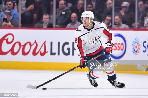 Madison Bowey of the Washington Capitals skates the puck against the Montreal Canadiens during the NHL game at the Bell Centre on November 1 2018 in...