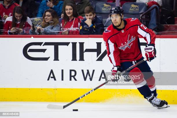 Madison Bowey of the Washington Capitals skates with the puck in the second period against the Tampa Bay Lightning at Capital One Arena on November...