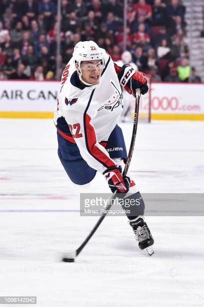 Madison Bowey of the Washington Capitals takes a shot against the Montreal Canadiens during the NHL game at the Bell Centre on November 1 2018 in...