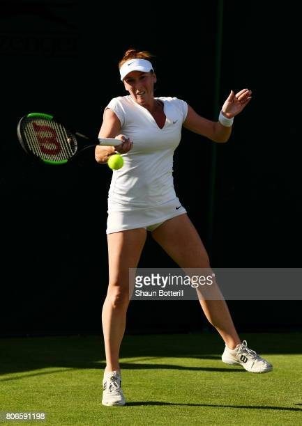 Madison Brengle of the United States plays a forehand during the Ladies Singles first round match against Richel Hogenkamp of the Netherlands on day...