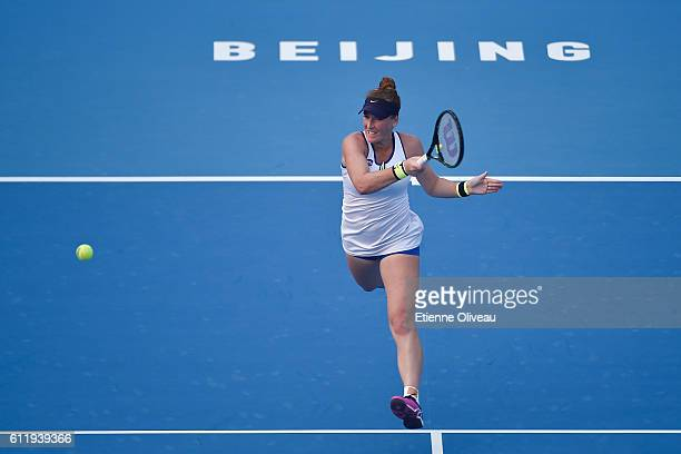 Madison Brengle of the United States plays a forehand in her match against Yanfan Wang of China during the Women's singles first round on day two of...