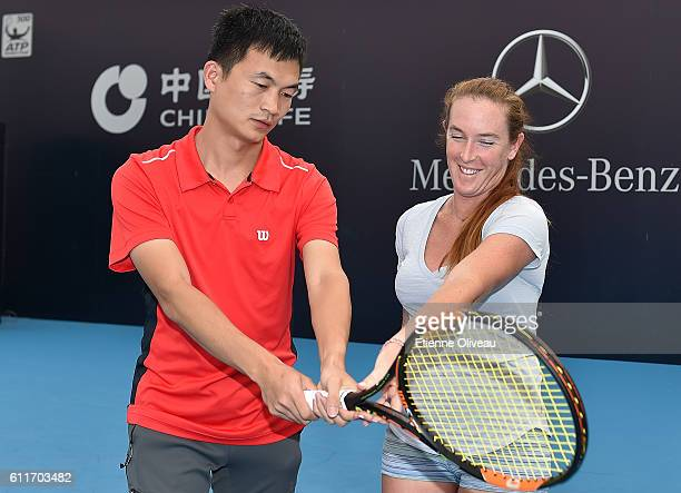 Madison Brengle of the United States teaches how to play a backhand during the Wilson Clinic event on day 1 of the 2016 China Open at the National...