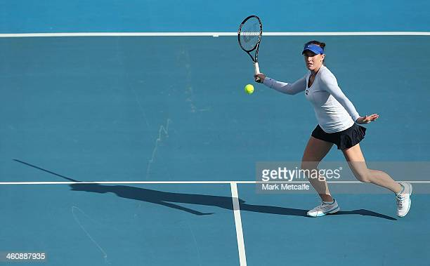 Madison Brengle of the USA plays a forehand in her first round match against Sam Stosur of Australia during day two of the Moorilla Hobart...