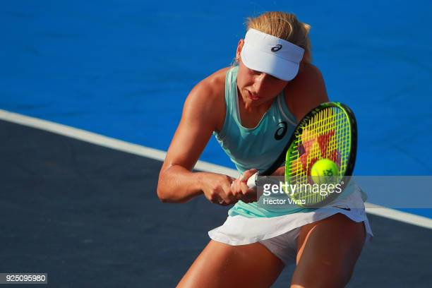 Madison Brengle of United States takes a backhand shot during the match between Madison Brengle of United States and Daria Gavrilova of Australia as...