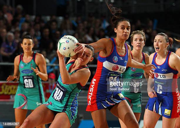 Madison Browne of the Vixens and Maria Tutaia of the Mystics compete for the ball during the round eight ANZ Championship match between the Melbourne...