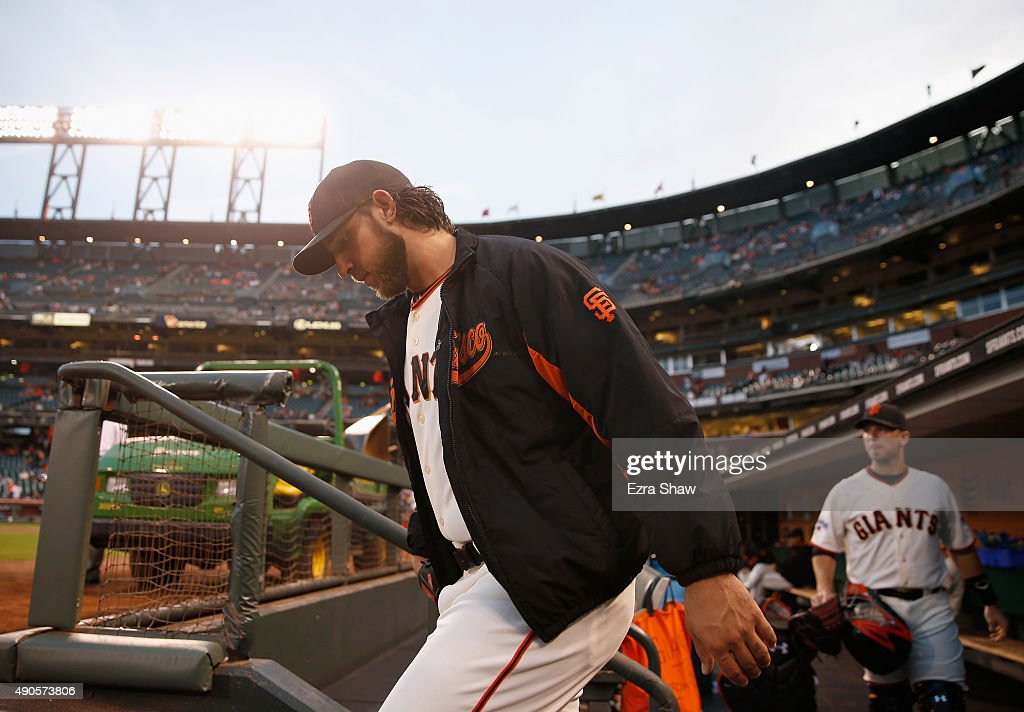Madison Bumgarner (left) #40 and Buster Posey #28 of the San Francisco Giants leave the dugout to warm up before their game against the Los Angeles Dodgers at AT&T Park on September 29, 2015 in San Francisco, California.