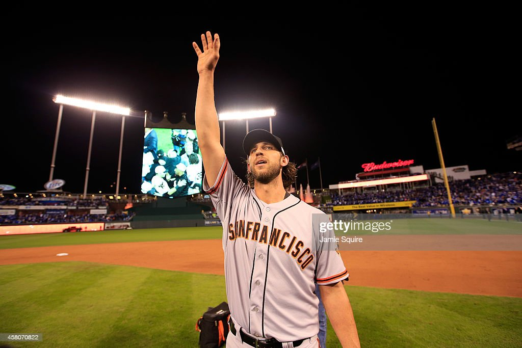 Madison Bumgarner #40 of the San Francisco Giants acknowledges the crowd after defeating the Kansas City Royals to win Game Seven of the 2014 World Series by a score of 3-2 at Kauffman Stadium on October 29, 2014 in Kansas City, Missouri.