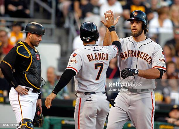 Madison Bumgarner of the San Francisco Giants celebrates his tworun homer with Gregor Blanco in the second inning during the game against the...