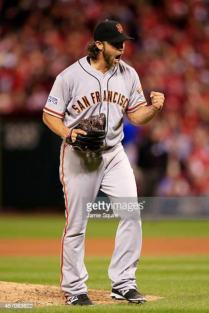 Madison Bumgarner of the San Francisco Giants celebrates the final out of the seventh inning against the St. Louis Cardinals during Game One of the...