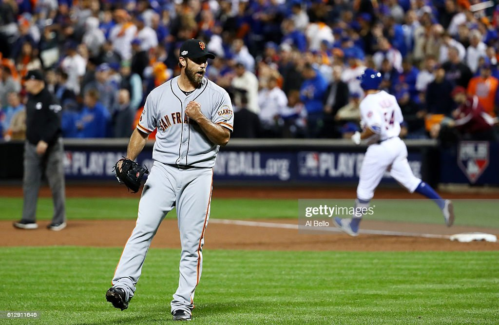 Madison Bumgarner #40 of the San Francisco Giants celebrates their 3-0 win over the New York Mets during their National League Wild Card game at Citi Field on October 5, 2016 in New York City.