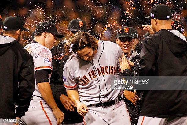 Madison Bumgarner of the San Francisco Giants celebrates with teammates after the defeated the Pittsburgh Pirates 8 to 0 in the National League Wild...