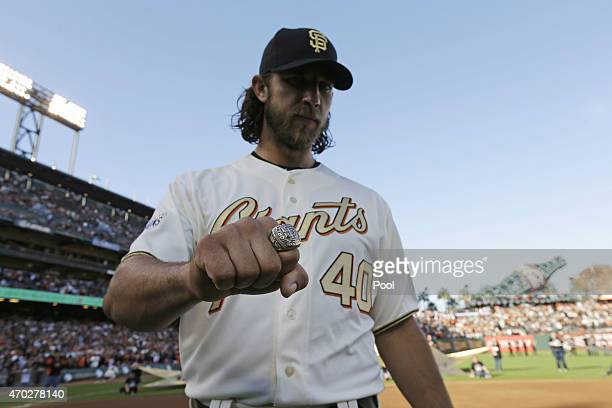 Madison Bumgarner of the San Francisco Giants displays his World Series ring during the San Francisco Giants 2014 World Series Ring ceremony before...