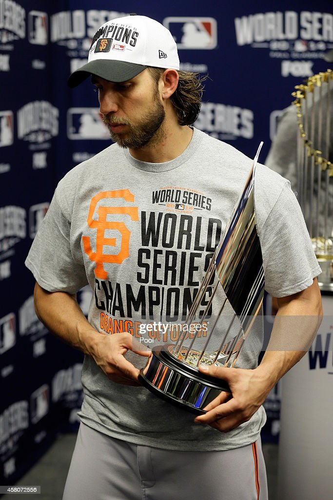 Madison Bumgarner #40 of the San Francisco Giants holds the MVP trophy following a 3-2 victory over the Kansas City Royals in Game Seven of the 2014 World Series at Kauffman Stadium on October 29, 2014 in Kansas City, Missouri.