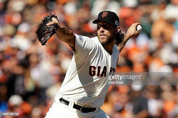 Madison Bumgarner of the San Francisco Giants pitches in the first inning against the Washington Nationals during Game Three of the National League...