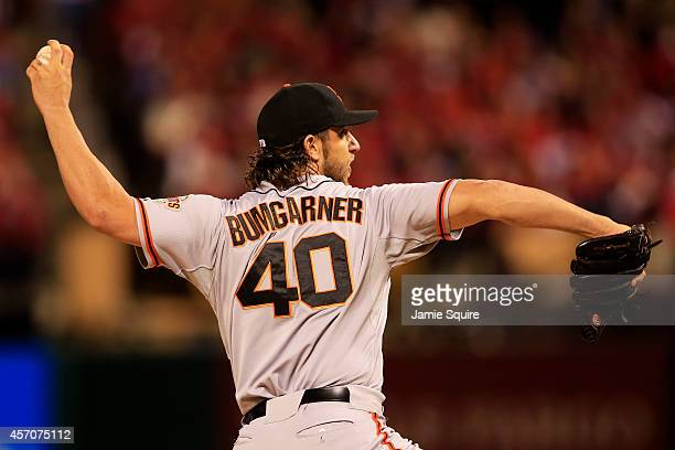 Madison Bumgarner of the San Francisco Giants pitches in the first inning against the St. Louis Cardinals during Game One of the National League...
