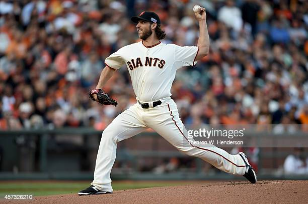 Madison Bumgarner of the San Francisco Giants pitches in the first inning while taking on the St Louis Cardinals during Game Five of the National...
